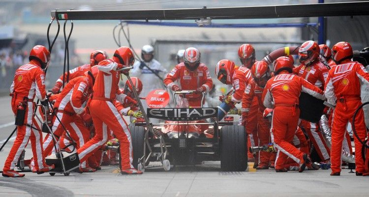 Felipe Massa of Brazil takes his Ferrari in for a pit stop during the Chinese Grand Prix at the Shanghai International Circuit on October 19, 2008.  Lewis Hamilton of Britain won the Chinese Grand Prix but was denied the world championship by title rival Felipe Massa, who finished second.           AFP PHOTO/GOH CHAI HIN (Photo credit should read GOH CHAI HIN/AFP/Getty Images)
