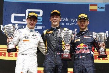2015 GP2 Series Round 2. Circuit de Catalunya, Barcelona, Spain.  Sunday 10 May 2015.  Alex Lynn (GBR, DAMS) celebrates on the podium with Stoffel Vandoorne (BEL, ART Grand Prix) and Pierre Gasly (FRA, DAMS). Photo: Sam Bloxham/GP2 Series Media Service.  ref: Digital Image _G7C4217