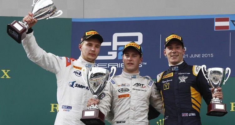 2015 GP2 Series Round 4.  Red Bull Ring, Spielberg, Austria.  Saturday 20 June 2015.  Stoffel Vandoorne (BEL, ART Grand Prix) celebrates his win on the podium with Sergey Sirotkin (RUS, Rapax) and Alex Lynn (GBR, DAMS). Photo: Sam Bloxham/GP2 Media Service  ref: Digital Image _G7C5350