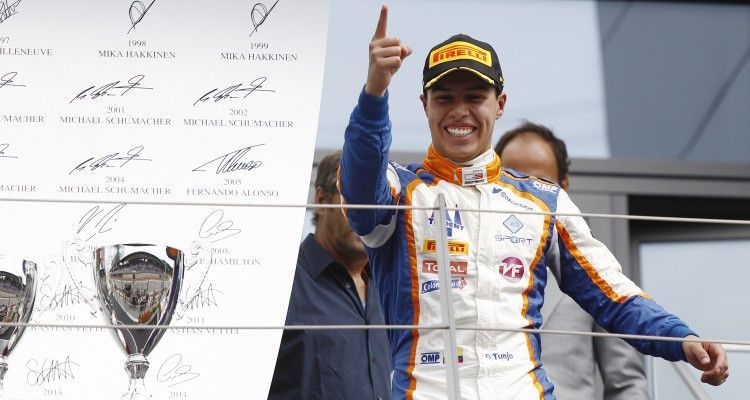 2015 GP3 Series Round 2.  Red Bull Ring, Spielberg, Austria.  Sunday 21 June 2015. Oscar Tunjo (COL, Trident) celebrates his win on the podium. Photo: Sam Bloxham/GP3 Media Service  ref: Digital Image _G7C5877