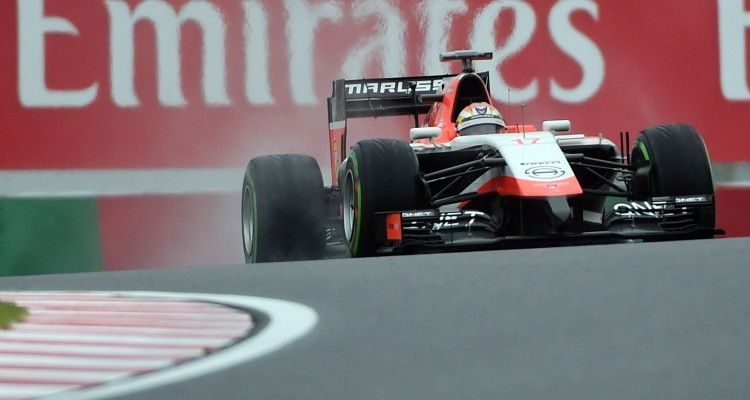 Marussia driver Jules Bianchi of France drives during the Formula One Japanese Grand Prix in Suzuka on October 5, 2014.   AFP PHOTO / TOSHIFUMI KITAMURA        (Photo credit should read TOSHIFUMI KITAMURA/AFP/Getty Images)