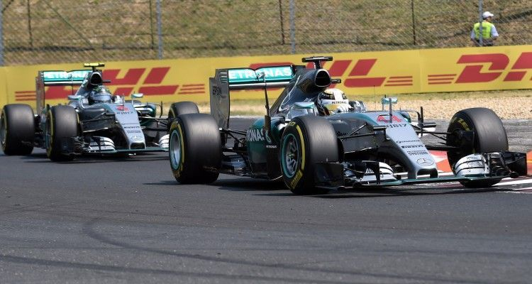 Mercedes AMG Petronas F1 Team's British driver Lewis Hamilton (R) drives ahead of his teammate German driver Nico Rosberg (L) during the third practice session on July 25, 2015 at the Hungaroring circuit near Budapest on the eve of the Hungarian Formula One Grand Prix.     AFP PHOTO / ATTILA KISBENEDEK        (Photo credit should read ATTILA KISBENEDEK/AFP/Getty Images)