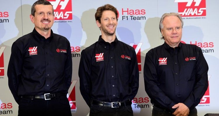 KANNAPOLIS, NC - SEPTEMBER 29:  (L-R) Gunther Steiner, team principal of Haas F1 Team, Romain Grosjean of France, and Gene Haas, owner of Haas F1 Team, pose for a photo opportunity after Haas F1 Team announced Grosjean as their driver for the upcoming 2016 Formula 1 season on September 29, 2015 in Kannapolis, North Carolina.  (Photo by Jared C. Tilton/Stewart-Haas Racing via Getty Images)