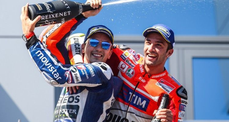 SPIELBERG,AUSTRIA,14.AUG.16 - MOTORSPORTS, MOTORCYCLE - MotoGP, Grand Prix of Austria, Red Bull Ring, award ceremony. Image shows the rejoicing of Jorge Lorenzo (ESP/ Yamaha) and Andrea Iannone (ITA/ Ducati)