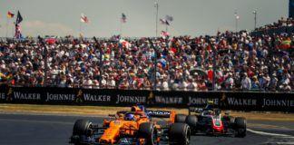 Fernando Alonso leading Kevin Magnussen