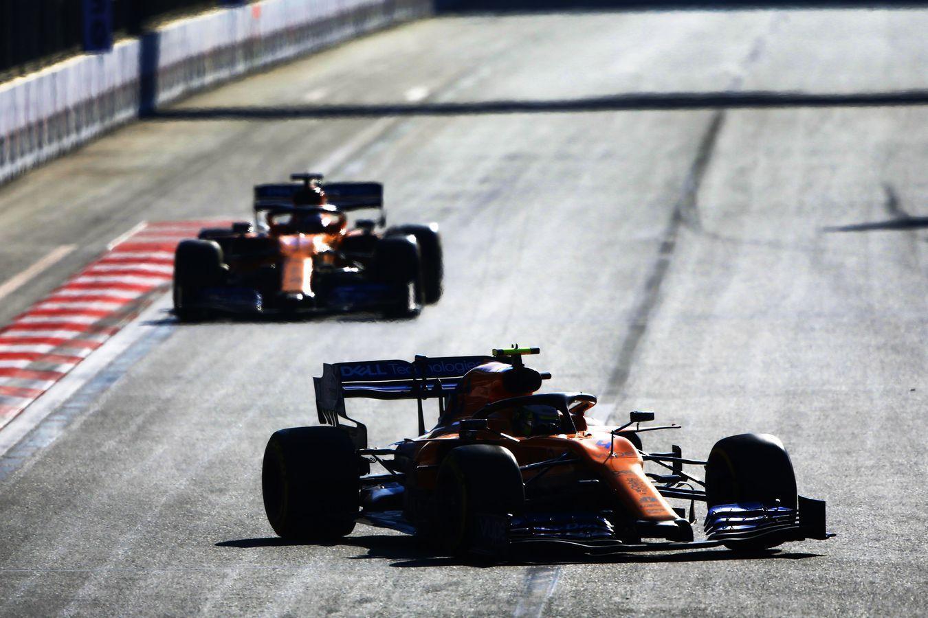 Lando Norris leads Carlos Sainz, McLaren