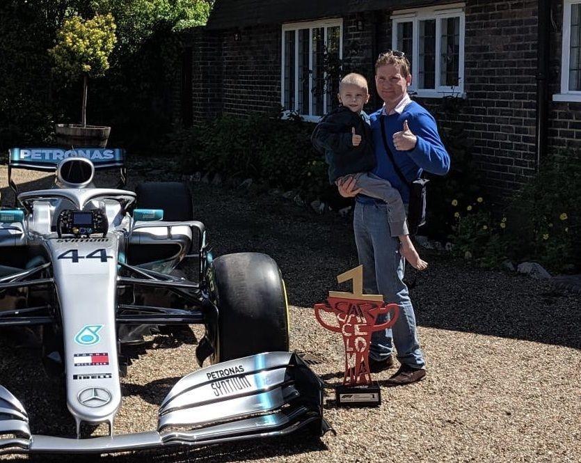 Harry Shaw with Lewis Hamilton Mercedes F1 car