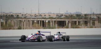 Francesco Pizzi and Lorenzo Fluxá from Xcel Motorsport batteling for the lead at Dubai Autodrome